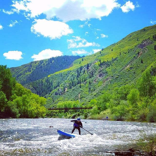 Stand up paddleboarding on the roaring fork river